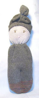 folk art sock doll embroidered eyes winter hat