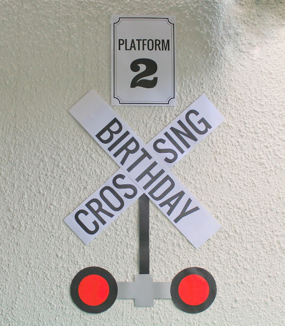 Platform 2 birthday crossing sign.