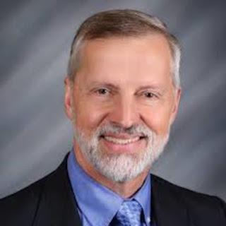 Dr. Andre Van Mol