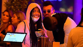 Jordyn Woods Snuggles Up To Mystery Man At Coachella [Photos]