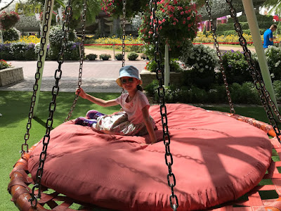 Girl in large swinging seat