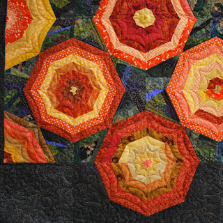 Pumpkin Patch at Midnight spiderweb quilt: QuiltBee