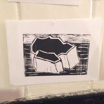 Black and white lino print of an iceberg