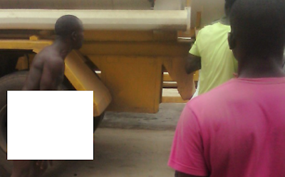man strip naked lagos filing station