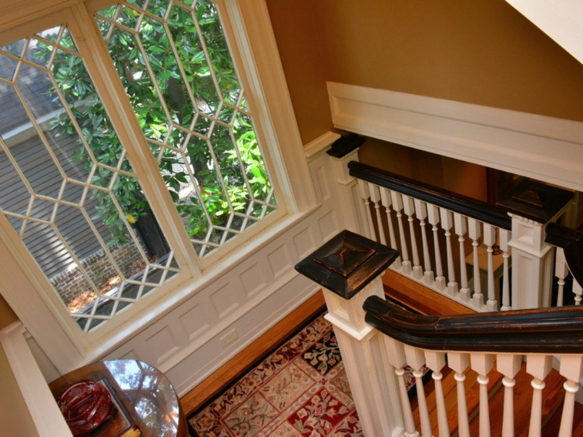 historic staircase with gorgeous window