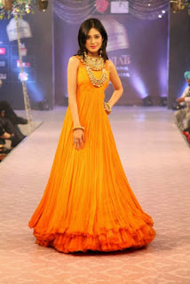 Amrita Rao in Orange Long Gown at Fashion Show
