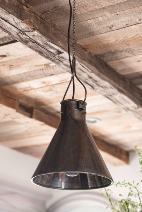 Rustic wood ceiling and vintage metal pendant. Come see this Rustic Elegant French Gustavian Cottage by Decor de Provence in Utah! #frenchcountry #frenchfarmhouse #interiordesigninspiration #rusticdecor #europeanfarmhouse #housetour