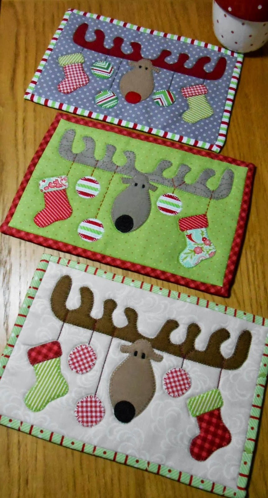 http://www.craftsy.com/pattern/quilting/home-decor/christmas-antlers-mug-rug/113926
