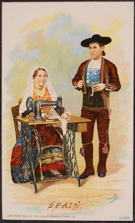 "An illustration of a man standing by a woman at a sewing machine, captioned ""Spain."""