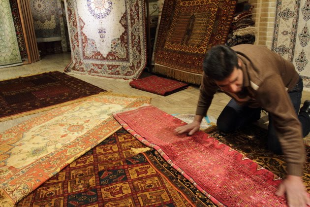 Exquisite silk Persian carpets at the grand bazaar of Isfahan, Iran
