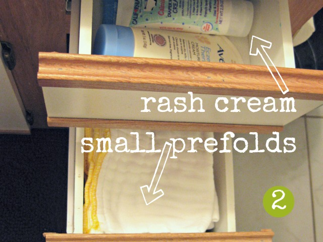 diaper rash cream and prefolds in bathroom drawers