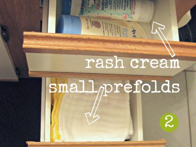 diaper rash cream and prefolds in bathroom drawers