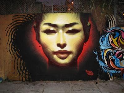Arte Urbano  Rostro de mujer asiatica.