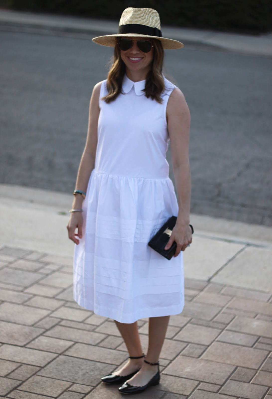 white dress and straw fedora