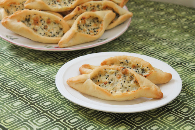 Food Lust People Love: A soft yeast dough filled with a blend of three salty cheeses, cilantro and nigella seeds, fatayer jebneh or Arabic cheese pies are baked till golden on the outside. The melted cheese on the inside is the perfect complement to the tender crust.
