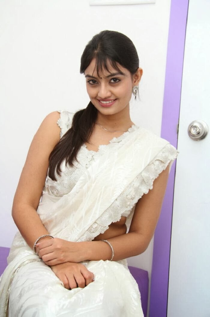 Nikitha narayan photos in white saree at homeo trend super speciality hospital launch