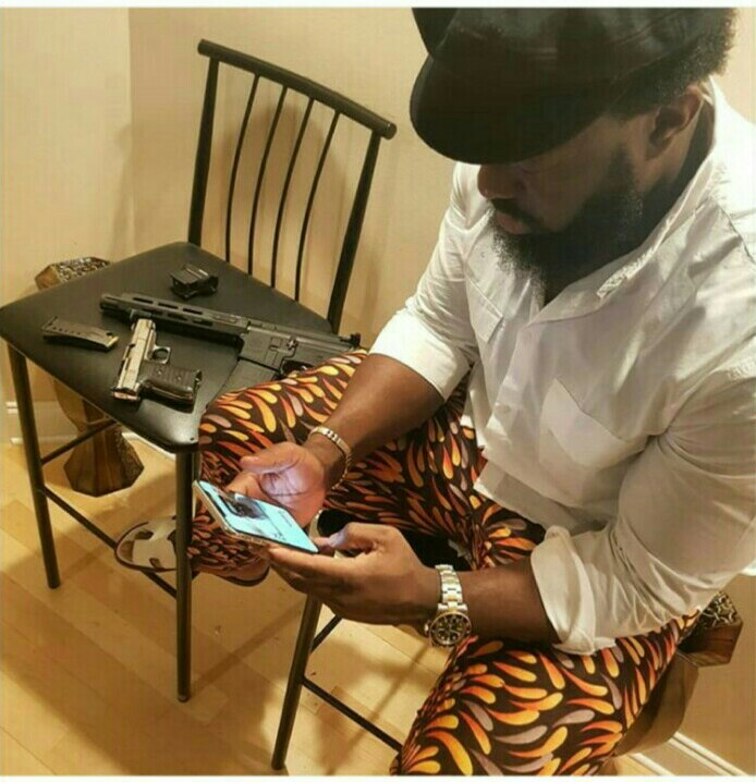 Timaya bosses up in new photo as he poses with guns