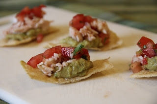 chips topped with guacamole, chicken and pico de gallo