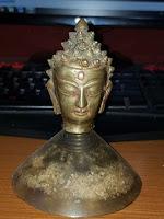 Arca Kepala Budha Wingit