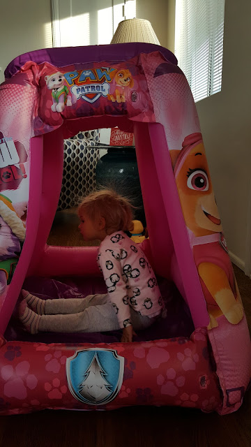 toddlers-opening-presents-inflatable-house