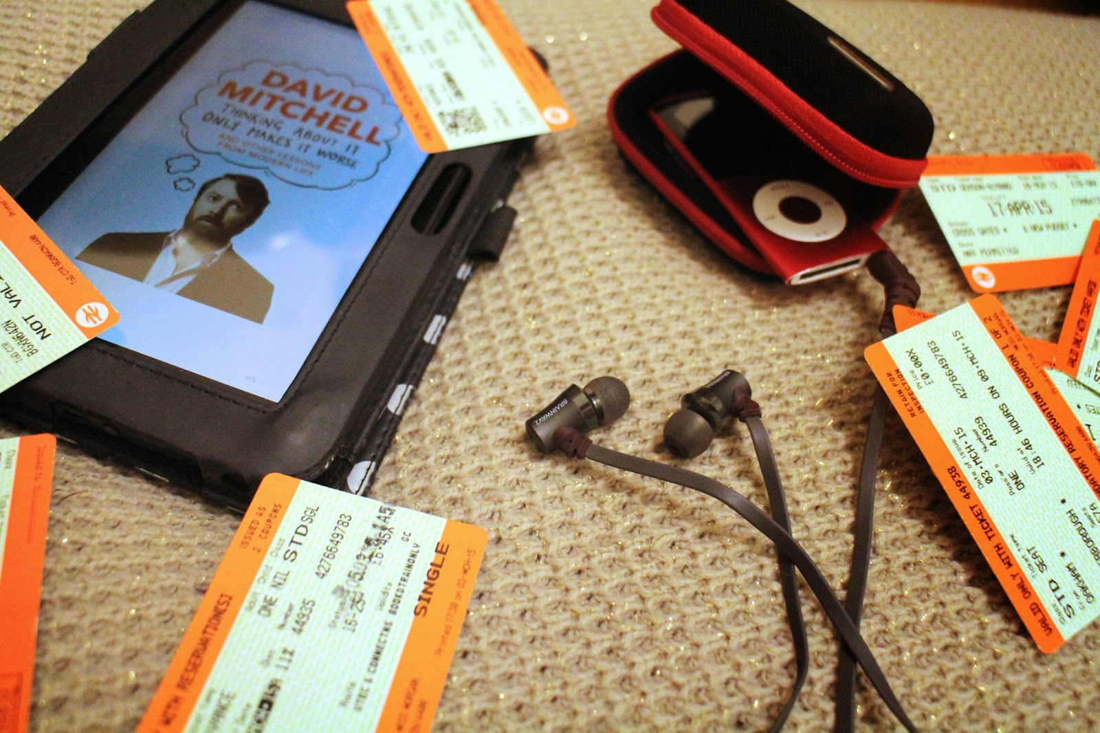 Brainwavz audio headphones, a kindle and train tickets