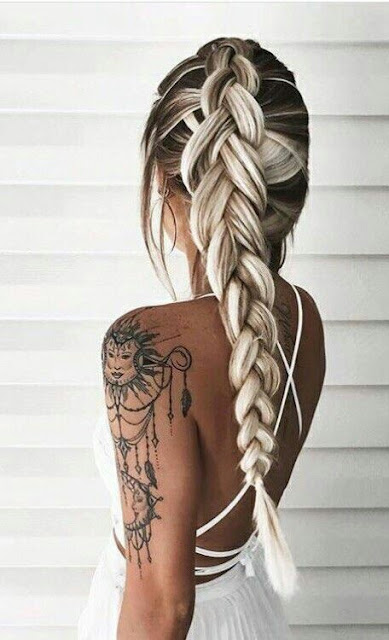 Fishtail-hairstyle-and-arm-tattoo