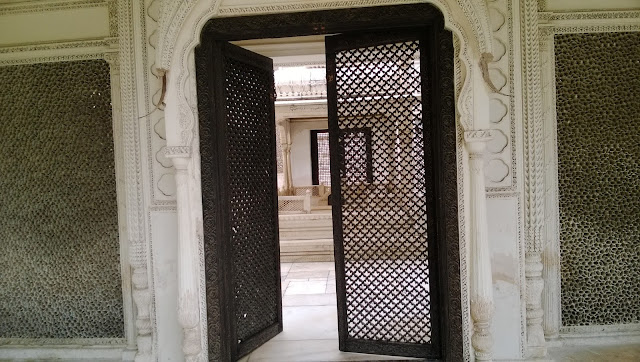 Close view of the opened door of the paigah tombs