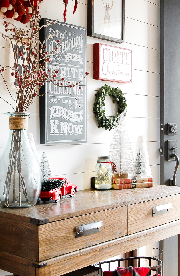 Classic red, white and gray Christmas entryway gallery wall