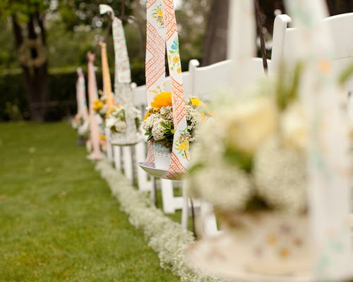 tea cups with florals lining ceremony aisle by heavenly blooms | photo by erin hearts court