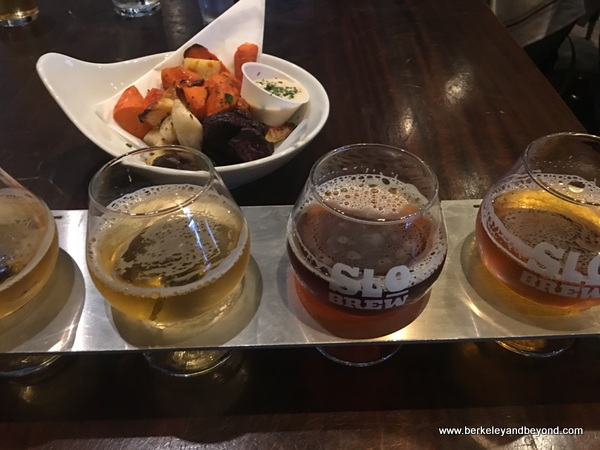 roasted roots and sampler beer flight at The Brew at SLO Brew in San Luis Obispo, California
