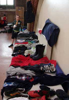 wet muddy clothes left behind after scout camp