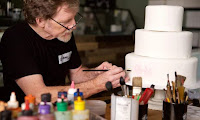 SUPREME COURT ADDRESSES GAY RIGHTS AND FREE SPEECH IN WEDDING CAKE CASE