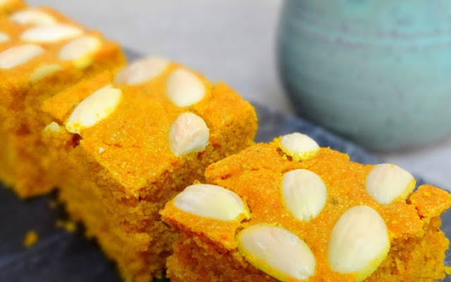 infused cake decorated with almonds that is popular in Lebanon Sfouf: Lebanese Almond and Turmeric Cake Recipe