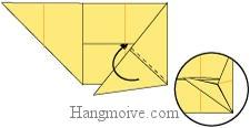 Bước 7: Gấp cạnh giấy vào trong khe giấy.