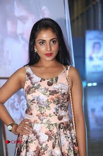 Actress Madhu Shalini Stills in Floral Short Dress at RGV Shiva to Vangaveeti Event  0021.JPG