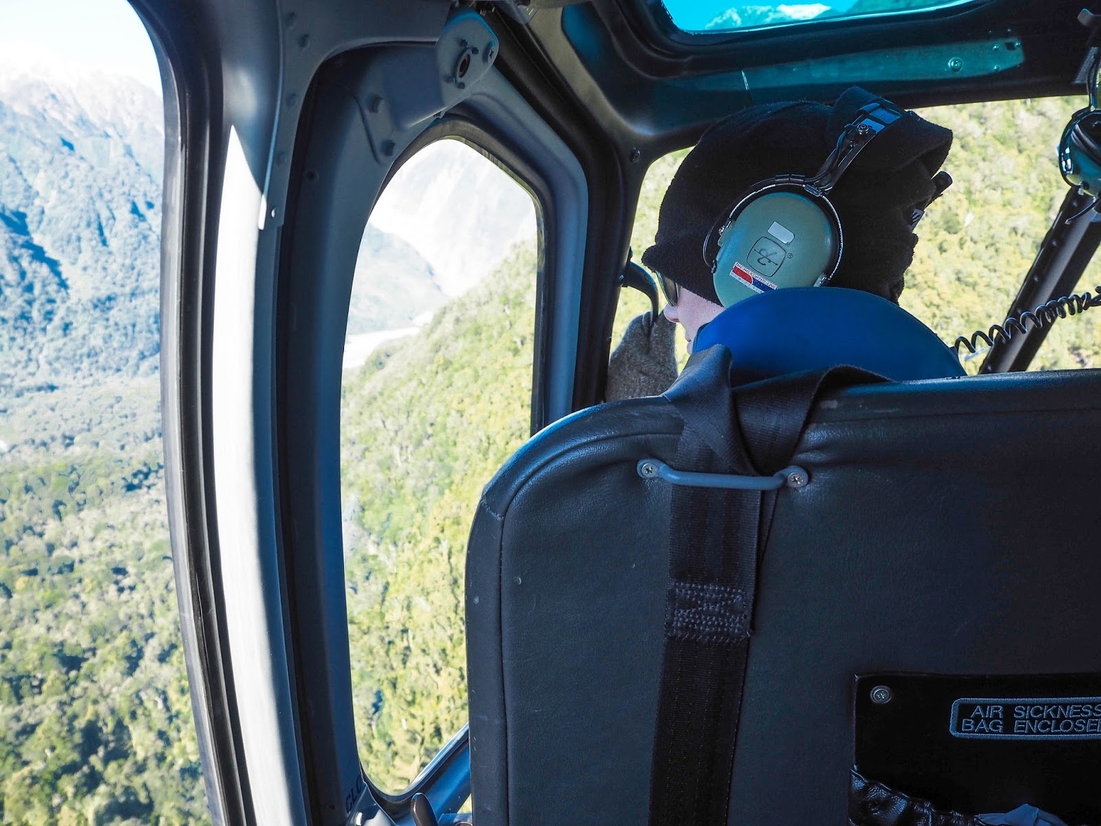 In a helicopter flying to Franz Josef glacier