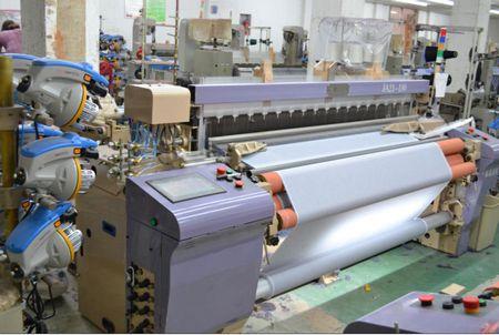 Air jet loom machine used in weaving factory