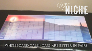 Set of two Vary Niche Fine Art Whiteboard Calendar with a sailboat and a lighthouse seascape.