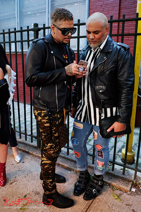 Two men, camo pants, denim jeans, black leather biker jackets. Street Fashion Sydney - New York Edition photographed by Kent Johnson