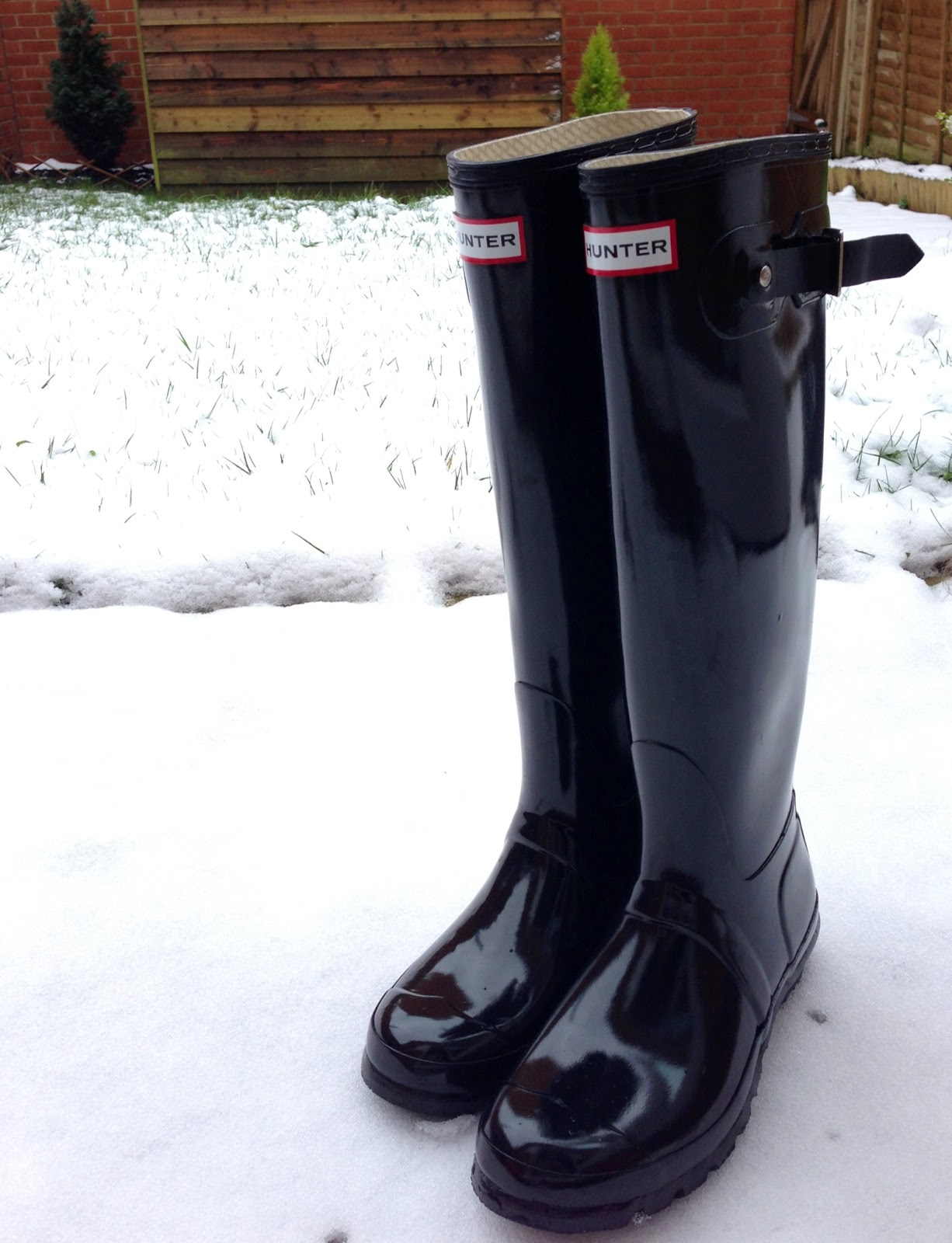 black glossy hunter boots