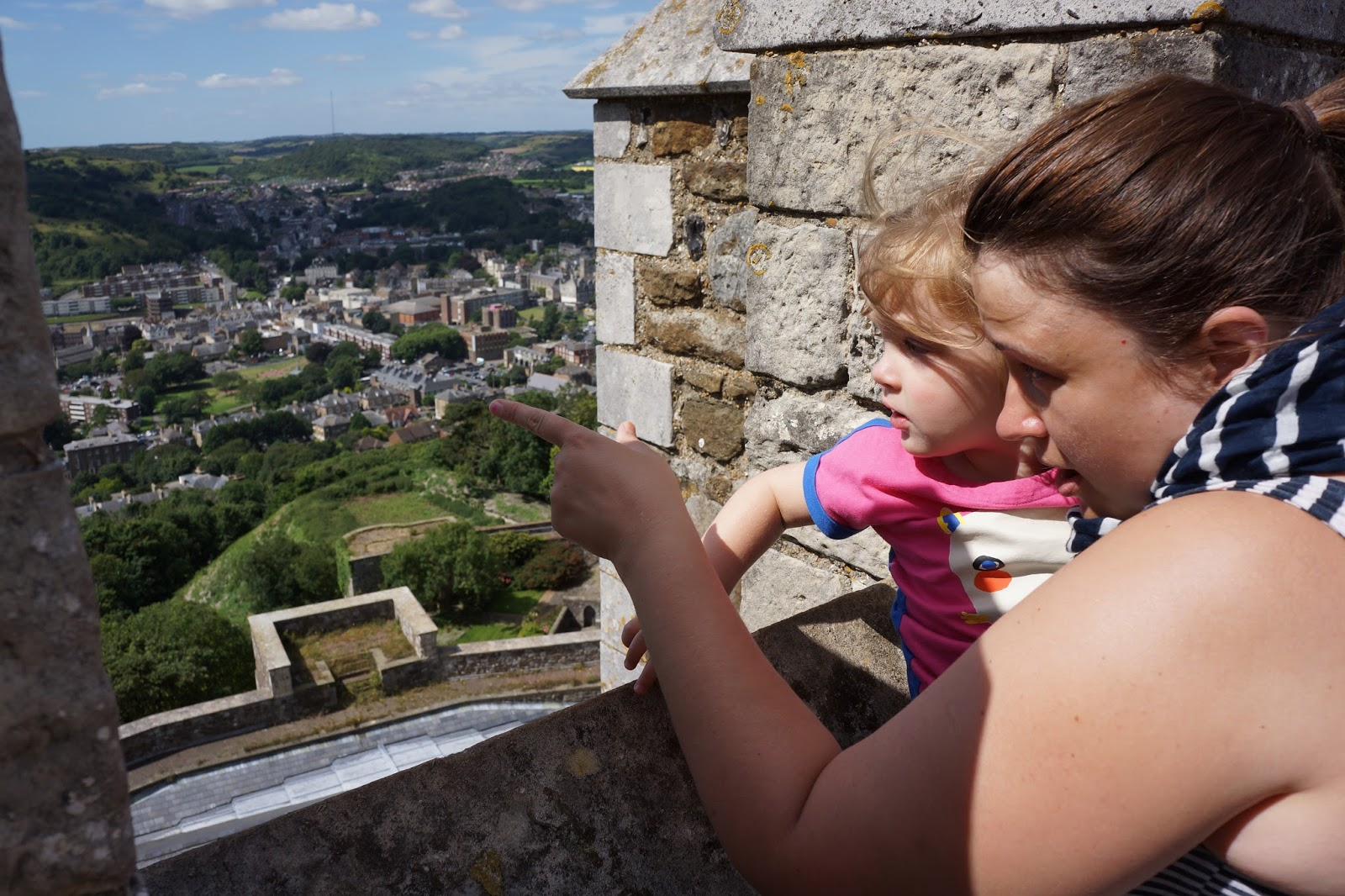 mummy and daughter looking at the view from dover castle tower