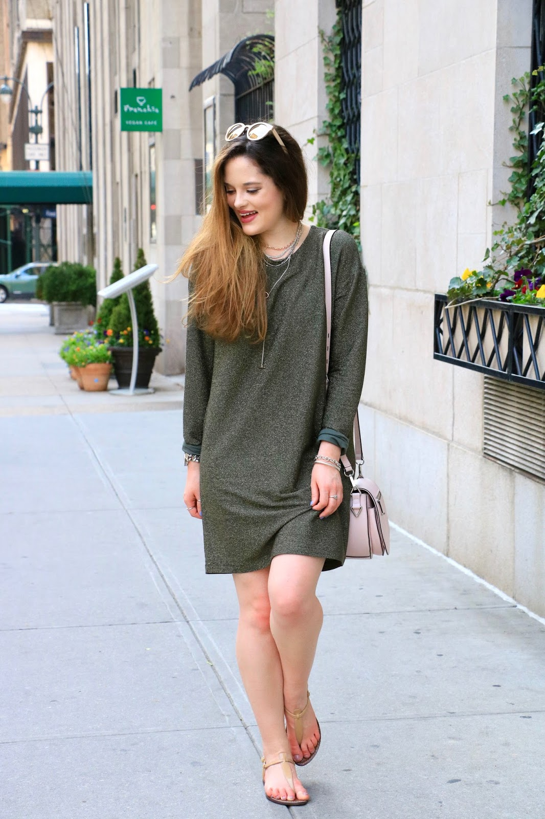 Fashion blogger Kathleen Harper wearing a green cutout dress