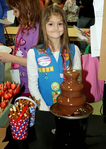 Tessa enjoyed chocolate fondue at Switzerland's booth.