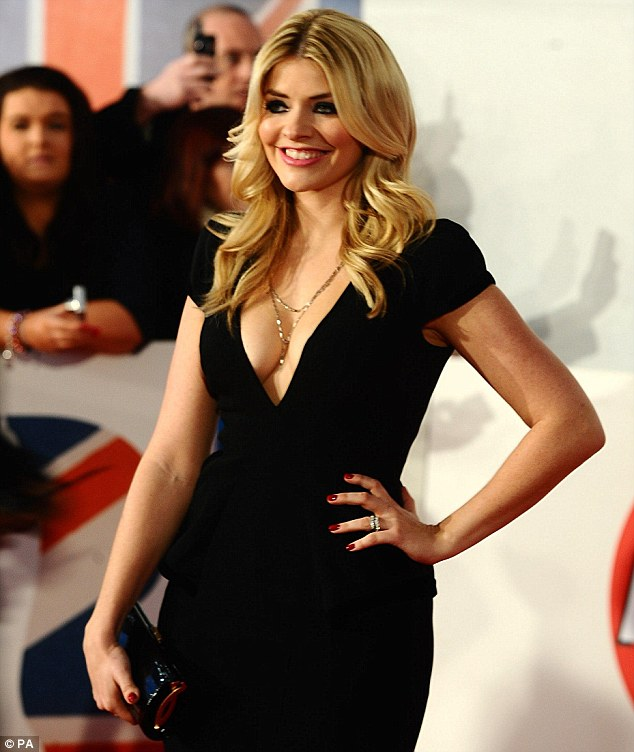 1de60085c34 Risque  This Morning host Holly Willoughby showed off her ample cleavage in  this very low-cut black dress