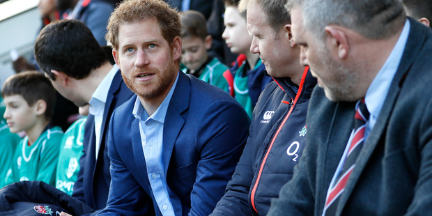 Britain's Prince Harry delights rugby supporters as he joins fans to watch the England team train