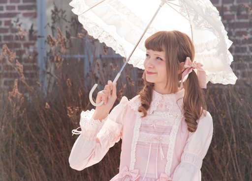 an old school lolita in a pink baby the stars shine bright dress and an umbrella