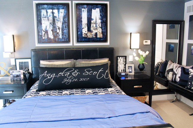 Blue NY Canvas Art Framed Above Bed