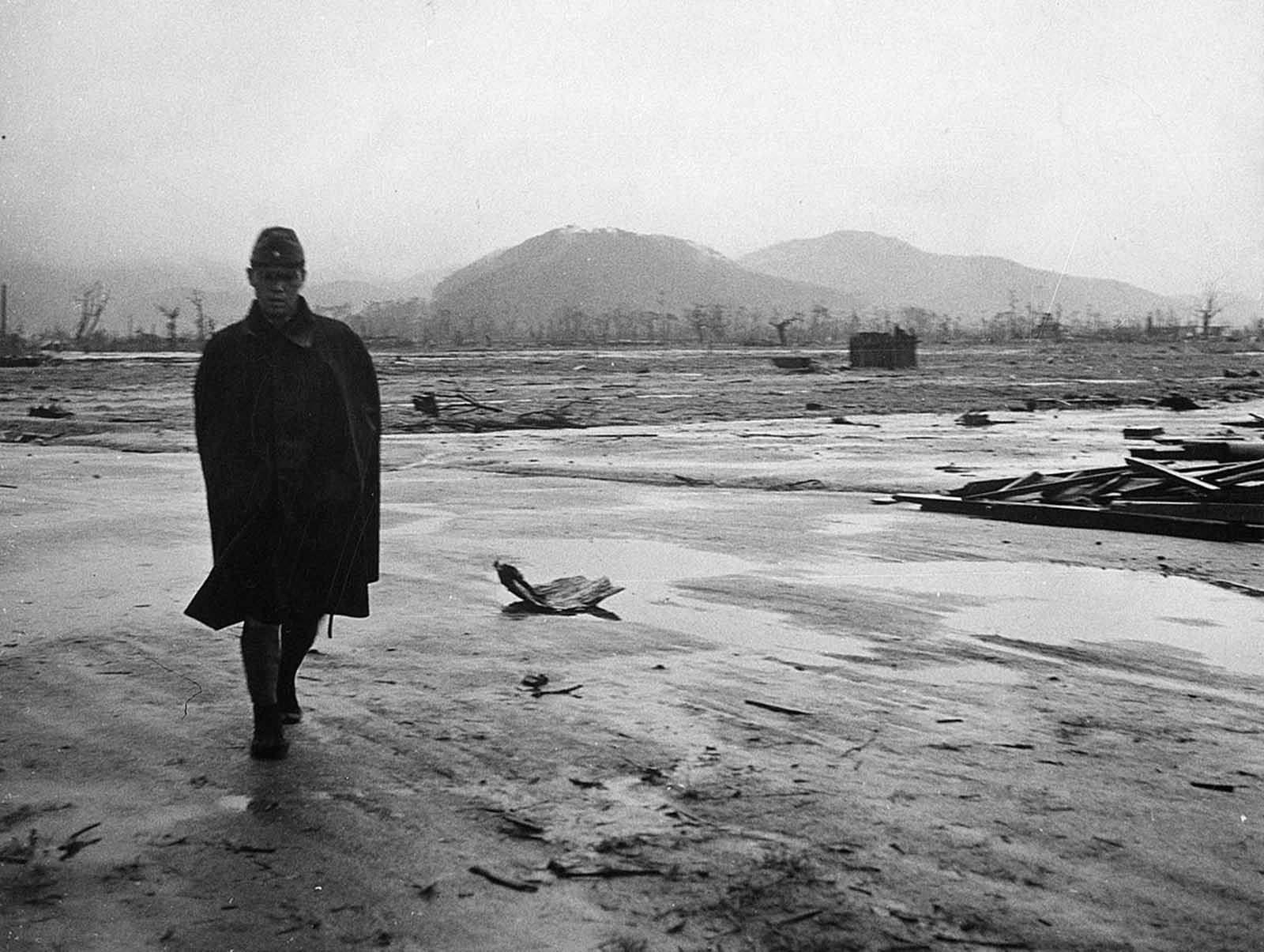 A Japanese soldier walks through a completely leveled area of Hiroshima in September of 1945.