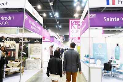 A row of various brands in the K-Beauty Expo.