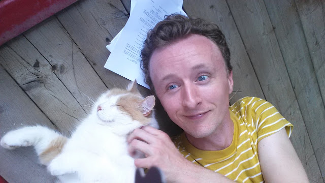 "Happy Cat on the Set of the Movie ""House of Tomorrow"" with Actor Paul Cram"